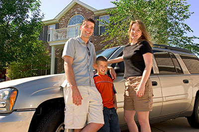 Family with family vehicle